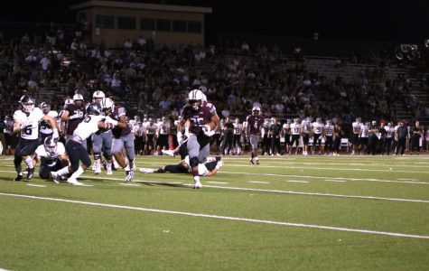 Running back Marquis Brown powers in a touchdown with four minutes left in the fourth quarter