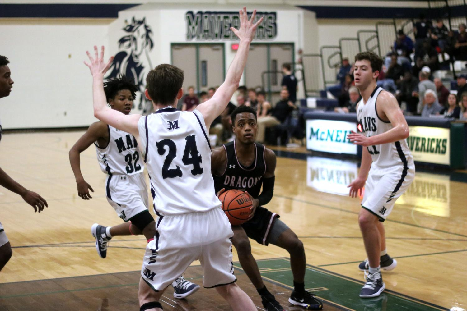 Ryan Ward drives into the paint during Round Rock's district battle with McNeil
