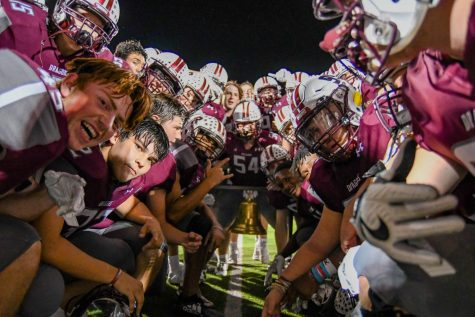 Round Rock players engulf the bell following a 67-21 win over Westwood.